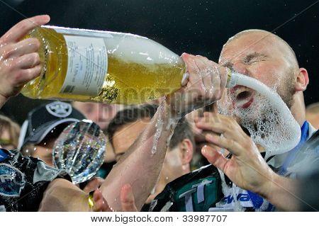 INNSBRUCK, VIENNA - JUNE 18: DL Benedikt Brugnara (#90 Raiders) celebrates the victory on June 18, 2012 in Innsbruck, Austria. The Swarco Raiders beat the Berlin Adler 27:12.