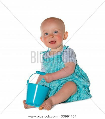 Adorable Baby Playing With A Bucket