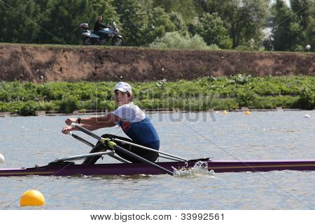MOSCOW, RUSSIA - JUNE 9: Sergey Syichyov (Moscow) in rowing competitions on single scull during 51th International Grand Moscow Regatta in Moscow, Russia on June 9, 2012