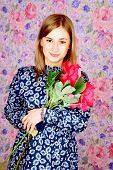 The Girl Holds A Bouquet With Pink Peonies On Tender Background. poster