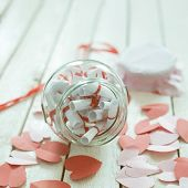 Valentines Day Concept. Opened Date Jar With Desires And Paper Hearts On Wood poster