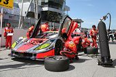 SEPANG - JUNE 10: Mechanics work on the Arta Garaiya car of the Autobacs Racing Team Aguri on race d