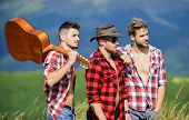 Long Route. Adventurers Squad. Men With Guitar Hiking On Sunny Day. Group Of Young People In Checker poster