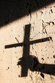 Shadow Of The Hand Holding A Christian Cross. Christian Symbol. poster