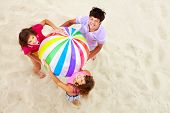 stock photo of beach-ball  - Above angle of happy teenage friends with multi - JPG