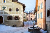 Winding street with  typical houses and fountain in the older part of Guarda, Inn District,  Swiss c poster