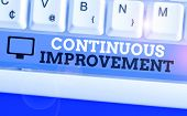 Handwriting Text Continuous Improvement. Concept Meaning Ongoing Effort To Improve Products Or Proce poster