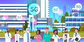 Mix Race Doctors Team Standing Together 5g Online Wireless System Connection Concept Clinic Workers  poster