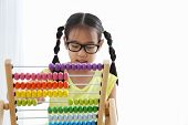 Brain Development At Early Childhood With The Abacus. Kindergarten Children Grabbing Colorful Wooden poster