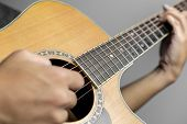Male Musicians Playing Acoustic Guitar. Closeup Musicians Are Playing Acoustic Guitar. Male Musician poster