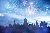 Exotic New Year - Celebrating the New Year in Thailand with fireworks at Wat Chai Watthanaram Buddhi poster