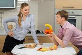image of indecent  - Happy Couple having fun on a kitchen - JPG
