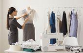 Dressmaker, Technologies, Fashion Designer And Tailor Concept - Young Female Fashion Designer Workin poster