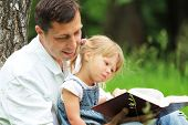 image of daughter  - a Father and daughter reading the Bible - JPG