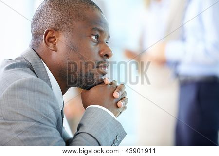 Handsome businessman daydreaming of his business future