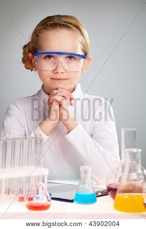Vertical portrait of an enthusiastic girl loving science