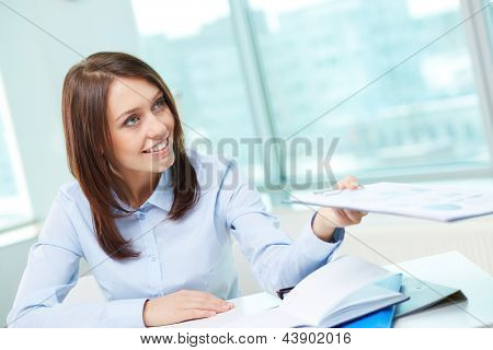 Young business lady providing her financial report