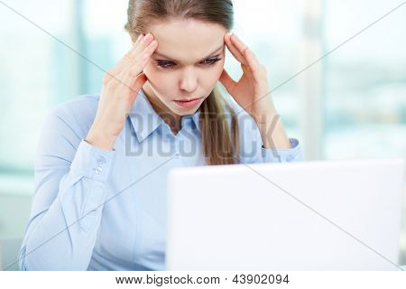 Overworking businesswoman suffering from headache