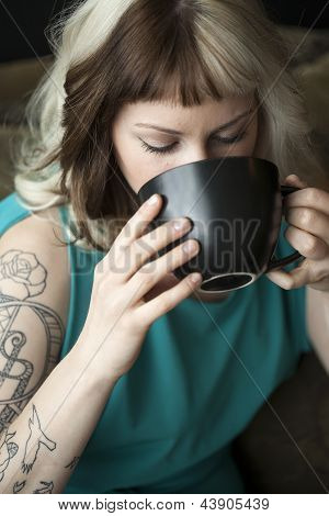 Beautiful Young Woman With Brown And Blond Hair Holding Black Coffee Cup