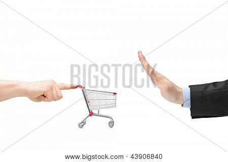 Finger pushing an empty shopping cart and male hand gesturing stop