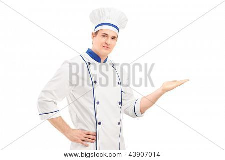 Male chef in a uniform gesturing with hand, isolated on white background
