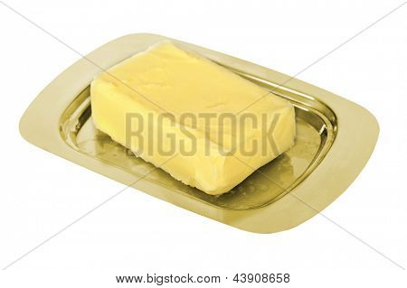 Butter on golden butter dish isolated on white background