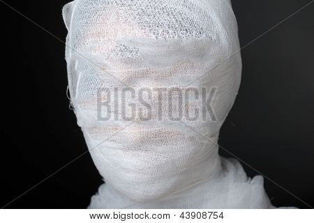 Portrait with bandaged face