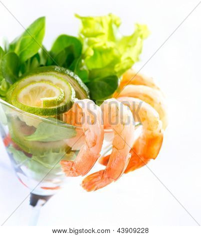 Shrimp or Prawn Cocktail. Isolated on a White Background. Healthy Shrimp Salad with mixed greens and tomatoes. Diet. Shrimps