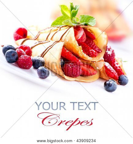 Crepes With Berries. Crepe with Strawberry, Raspberry, Blueberry and Chocolate topping. Pancake