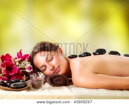 Spa Stone Massage. Beauty Treatments. Beautiful Girl Getting Spa Hot Stones Massage Outdoor. Spa Salon