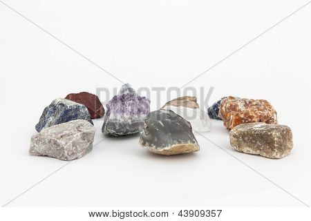Composition Of Various Crystals On White Background.