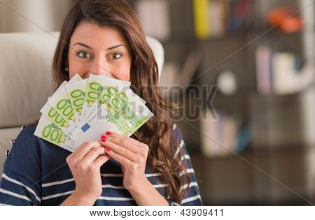 Happy Woman Holding Euro Currency, Indoors