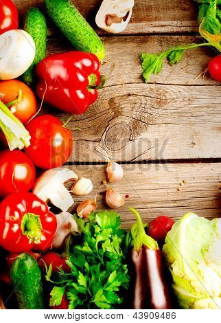 Healthy Organic Vegetables on a Wooden Background. Vertical Frame Design