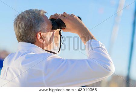 Mature Man Looking Through Binocular, Outdoors