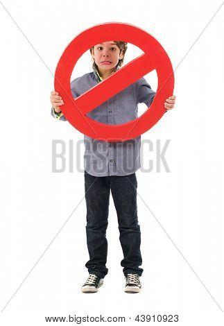 Portrait Of Boy Holding Prohibit Sign Isolated On White Background