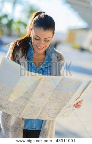 Happy Beautiful Woman Looking In Map, Outdoors
