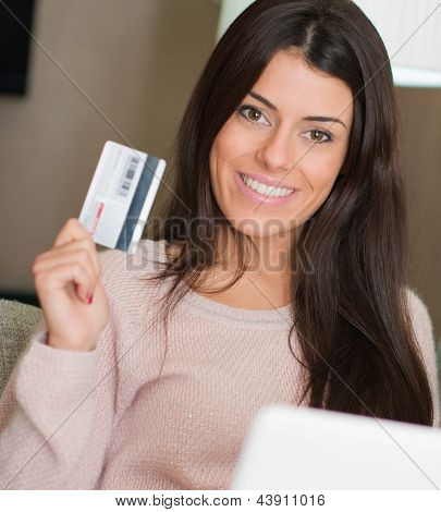Portrait Of Woman Holding Credit Card, Indoors