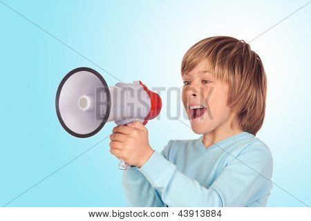 Portrait of adorable child with a megaphone isolated on a over blue background