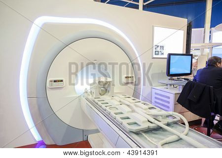 Representative sits on the exhibition of medical equipment