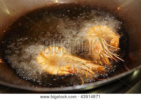 Prawns being fried in wok pan, asian restaurant
