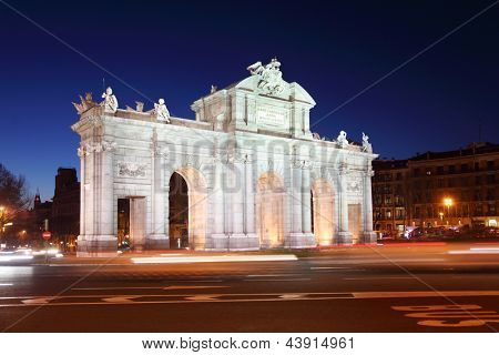 Arch Puerta de Alcala at Independence of Spain square at night in Madrid, Spain.