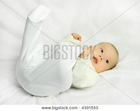 Cute Baby On The White Sofa