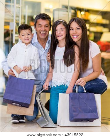Family at the shopping center looking very happy