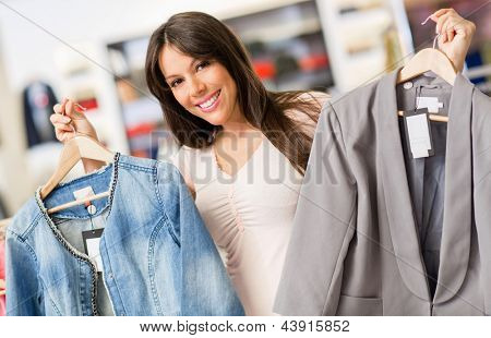 Happy shopping woman buying clothes at a store