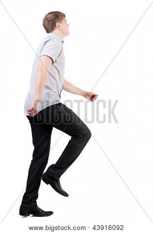 back view of running business man . walking businessman in motion. Rear view people collection.  backside view of person. Isolated over white background. quickly rushes young man isomewhere