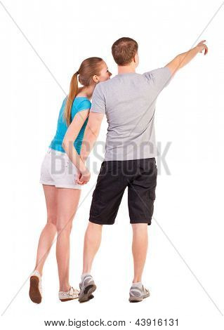 Back view of young couple pointing (woman and man). Rear view people collection.   backside view of person.  Isolated over white background. couple considering something, pointing at it with his hands