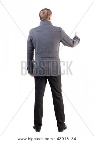 Back view business man shows thumbs up.  Rear view people collection. office worker shows positive.  backside view of person.  Isolated over white background. stylish guy in the coat shows