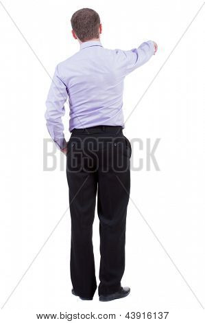 Back view of pointing business man. Rear view people collection.  backside view of person.  Isolated over white background. office worker in a shirt and trousers powerfully indicates something Side