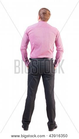 back view of business man in red shirt looks ahead. Young businessman watching.  Rear view people collection. backside view of person.  Isolated over white. office worker with sports figure looks away
