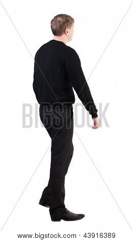 back view of walking business man. going young guy in red shirt. Isolated over white background. Rear view people collection. backside view of person. cheerful office worker proudly marching towards